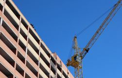 Brick building under construction crane construction site workers royalty free stock photo