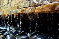 Brick Fountain. Flowing water through bricks and rocks Stock Photos