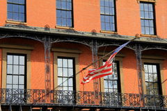 Brick front building with black railings and American flag Royalty Free Stock Images