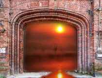 Brick gate and sunrise Stock Image