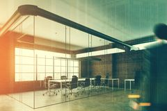 Brick and glass open space office, man Royalty Free Stock Image