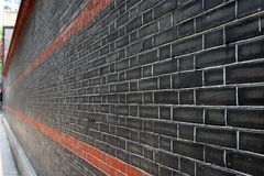 Brick gray wall with red line. Through the center royalty free stock photography