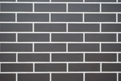 Brick gray wall, white stripes royalty free stock images