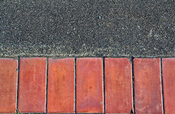 Brick on the ground. Brown brick on the concrete Royalty Free Stock Photo
