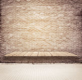 Brick grunge weathered brown wall with wooden shelf, table surface, walkway Royalty Free Stock Photo