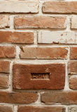 Brick with a hallmark in the loft style Royalty Free Stock Images