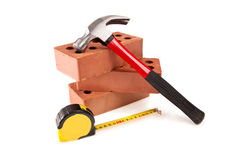 Brick , hammer And meter Royalty Free Stock Images