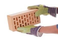 Brick in hand Royalty Free Stock Photo