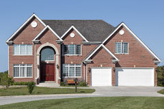 Brick home with arched entrance Royalty Free Stock Images