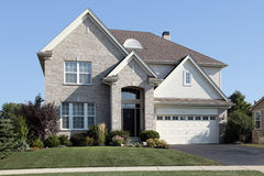 Brick home with arched entrance Stock Image