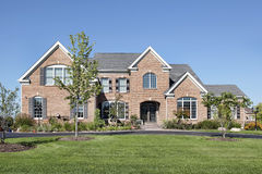 Brick home with arched entry Stock Images