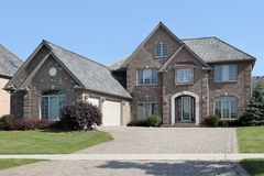 Brick home with arched entry Stock Photography