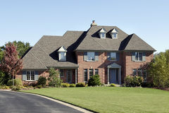 Brick home with arched entry Royalty Free Stock Photography