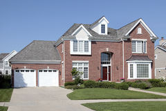 Brick home with arched entry Royalty Free Stock Image