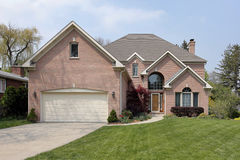 Brick home with arched window. Suburban brick home with arched window above entry royalty free stock photography