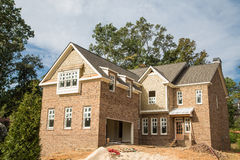 Brick Home Construction with New Windows Royalty Free Stock Image