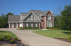 Brick home with drive way Stock Photos