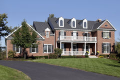 Brick home with front balcony and porch Royalty Free Stock Photography