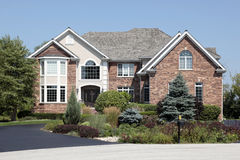 Brick home with front landscaping. Large brick home with front landscaping stock image