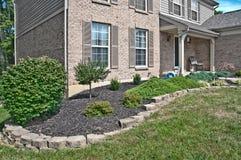 Brick Home Landscaping Beds. Suburban Neighborhood Brick Home Landscaping Beds- a spring day in the burbs stock photos