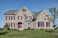Brick home with pink door Stock Images