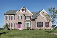 Brick home with pink door Stock Images