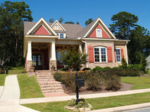 Brick Home With Porch and Gables Royalty Free Stock Photos