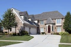 Brick home with red wood door Stock Images
