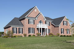 Brick home with white balcony Royalty Free Stock Photos