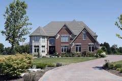 Brick home with white stone turret Royalty Free Stock Photos