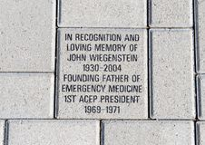 Brick in honor of John Wiegenstein, EMF Plaza, National ACEP Headquarters, Dallas, Texas. Pictured is the brick honoring John Wiegenstein MD,  in the EMF Plaza Stock Photos