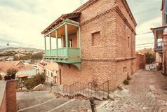Brick house with balcony, facade in traditional style built in historical area of Tbilisi, Georgia country.  royalty free stock photography