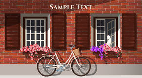 Brick house and bicycle Stock Images