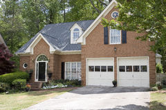 Brick House Black Door. A nice brick house with a black door and two car garage Royalty Free Stock Images