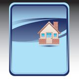 Brick house on blue background Royalty Free Stock Images
