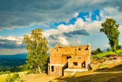 Brick house built in the mountains. stock photography