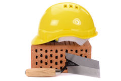 Brick for house construction and tool Stock Photos