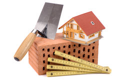 Brick for house construction and tool Stock Photography