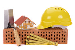 Brick for house construction and tools Royalty Free Stock Photo