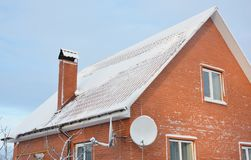 Brick house covered snow in winter royalty free stock photo