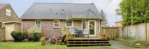 Brick house with cozy patio area Royalty Free Stock Photography