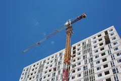 Brick house and a crane Stock Photo