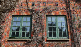 Brick house detail with windows Royalty Free Stock Images