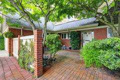 Brick house exterior with tile floor front yard Stock Photography
