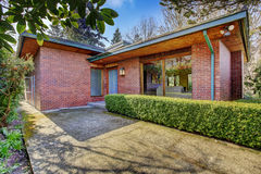 Brick house exterior. View of entrance porch Royalty Free Stock Images