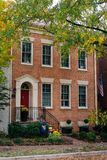 Brick house and fall color in Alexandria, Virginia stock image