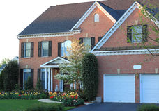 Brick House with Flowerbed. Brick House with front Flowerbed in Spring Royalty Free Stock Photo