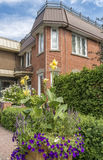 Brick House with flowers Stock Images