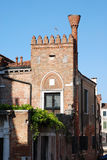 The brick house with a flue on the street of Venice. Royalty Free Stock Photo
