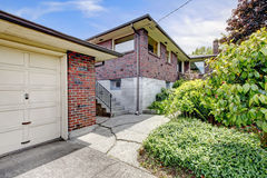 Brick house with garage Stock Images